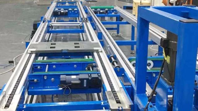 光良地轨倍速链流水线生产100KG负重中稳定运行